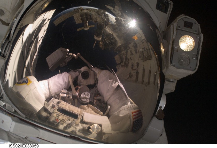 "The space station as reflected in John ""Danny"" Olivas' spacesuit visor on September 3, 2009 (NASA)"