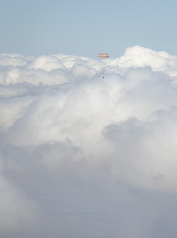 The Soyuz TMA-03M spacecraft parachute contrasts with the cloud over Kazakhstan minutes before touchdown. Credit: Bill Ingalls/NASA
