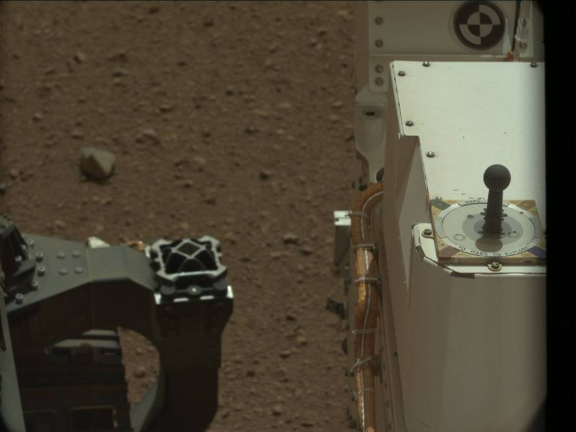 "Curiosity's sundial on its deck reads: ""Mars 2012 -- To Mars To Explore"""