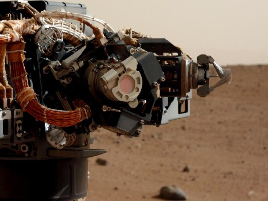 The left eye of the Mast Camera (Mastcam) on NASA's Mars rover Curiosity took this image of the camera on the rover's arm, the Mars Hand Lens Imager (MAHLI), during the 30th sol of the rover's mission on Mars (Sept. 5, 2012).
