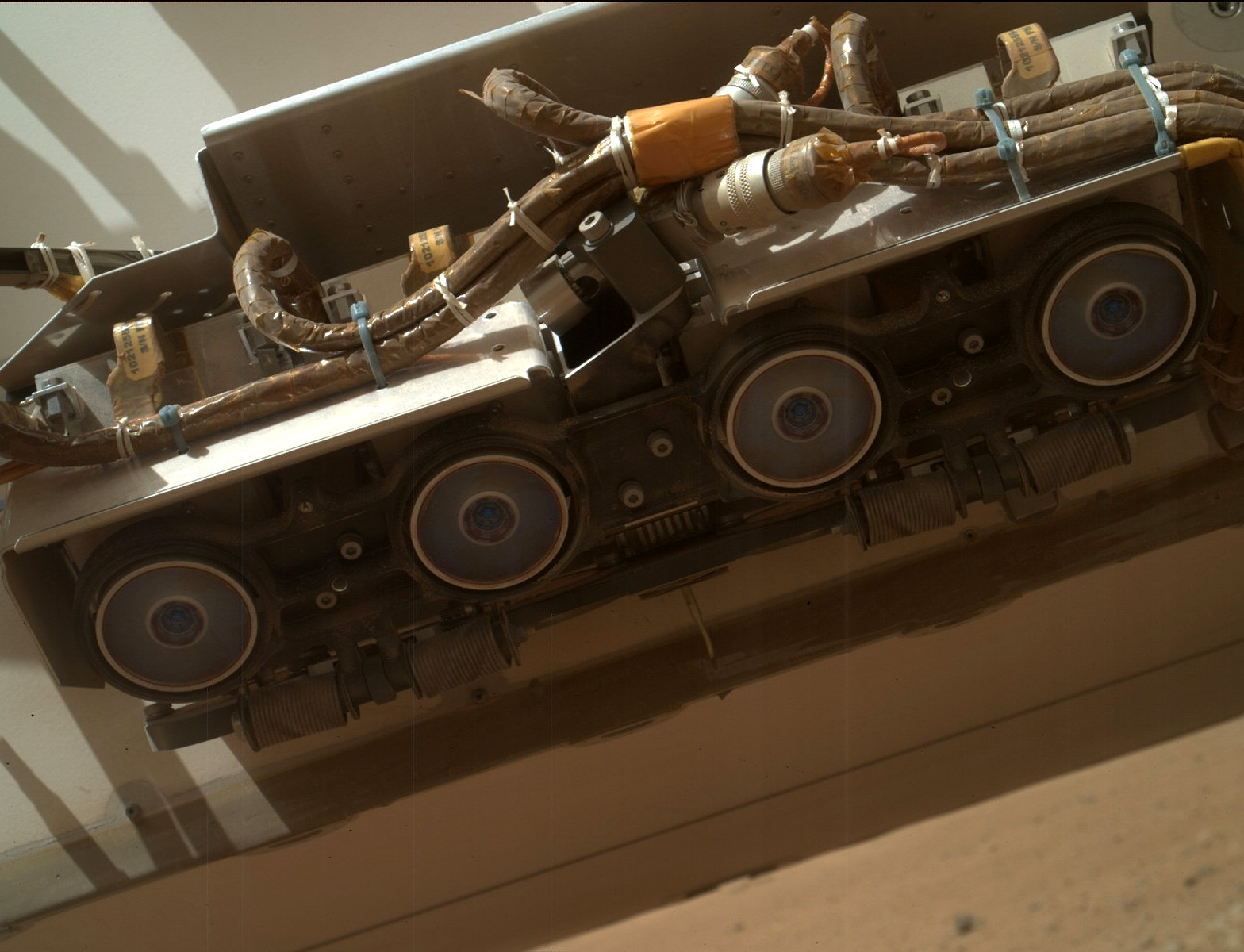 Curiosity's front Hazcams as imaged by the robotic arm-mounted MARDI camera. Credit: NASA/JPL-Caltech