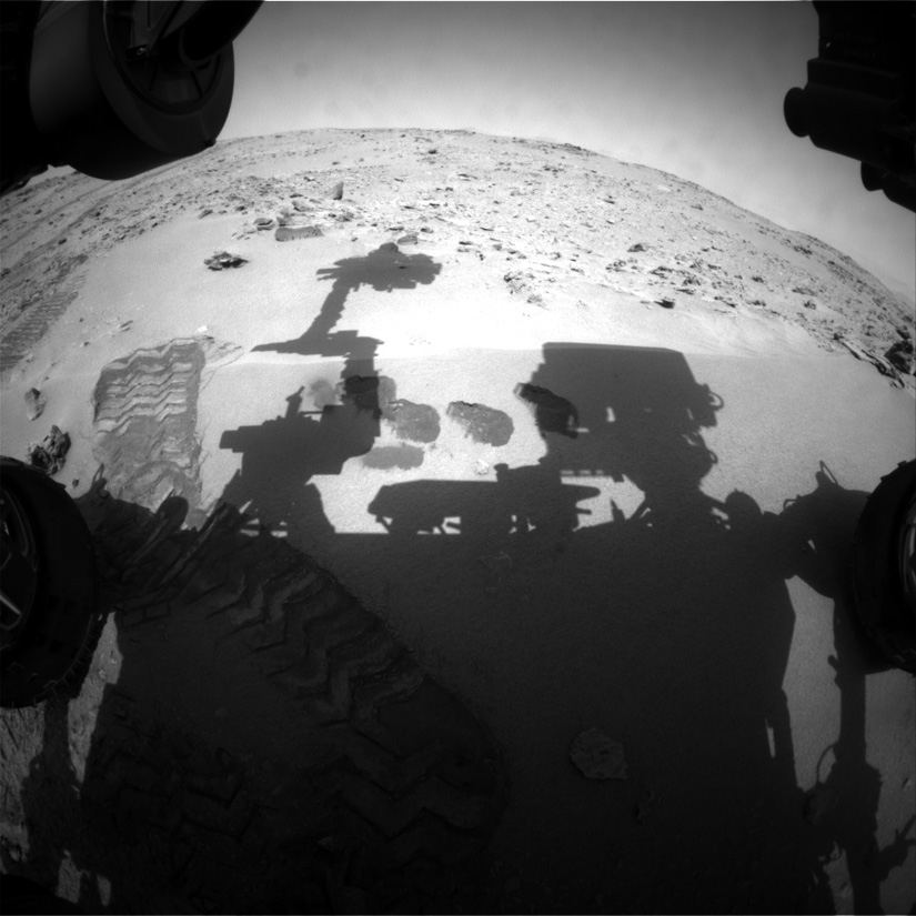 A view from Curiosity's front hazcam of the sandy Mars soil the rover scooped samples of for analysis by its SAM instrument (NASA/JPL-Caltech)